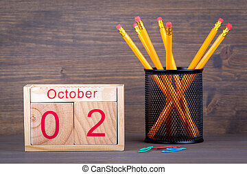 October 2. close-up wooden calendar. Time planning and business background