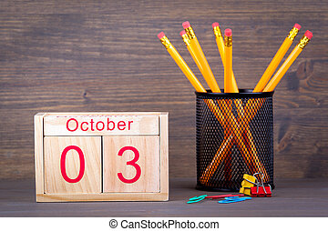 October 3. close-up wooden calendar. Time planning and business background