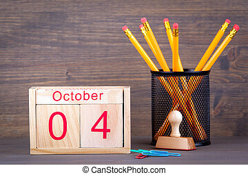 October 4. close-up wooden calendar. Time planning and business background