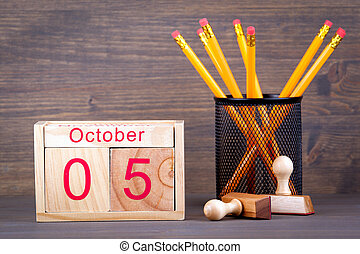 October 5. close-up wooden calendar. Time planning and business background