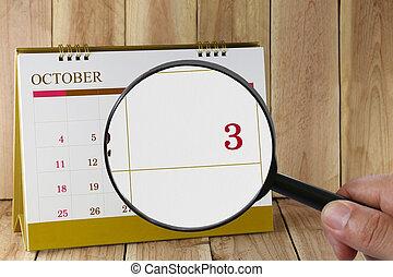october., harmadik, konzerv, magasztalás, hónap, naptár, szám 3, néz, dátum, kéz, összpontosít, pohár, ön