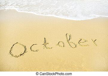 october - October - written in sand on beach texture