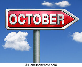 October pointing to next month of the year autumn road sign...