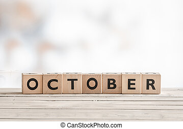 October sign made of wooden cubes