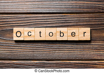 October word written on wood block. October text on wooden table for your desing, Top view concept