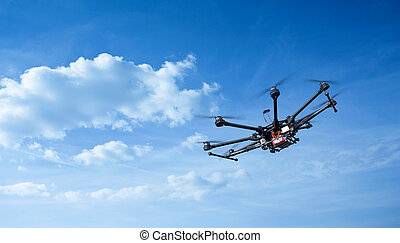 Octocopter, copter, drone - Copter flight against the blue ...