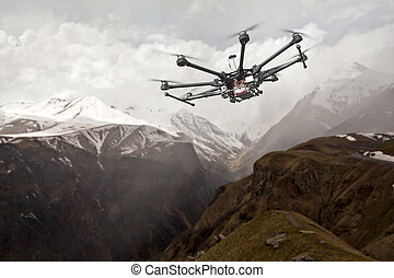 Octocopter, copter, drone - Copter flying over mountainous ...