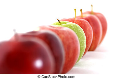 Odd One Out - A green apple stands out as being different in...