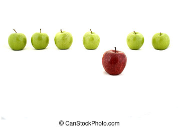 A red apple stands out from a line of green apples