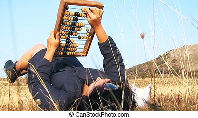 Odd Woman In Black Playing With Abacus At Nature