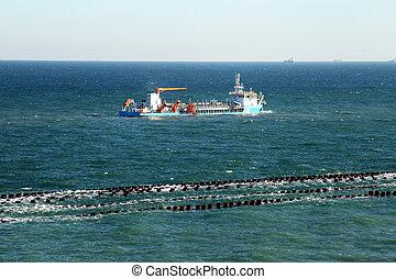 ODESSA, UKRAINE - APRIL 18: dredging the harbor fairway Odessa Commercial Sea Port in the construction of a new cargo container terminal , April 18, 2014 Odessa, Ukraine