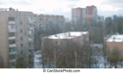 Odintsovo, Moscow region, Russia. Winter sunny snowy day. Blurred background, falling snow in focus.