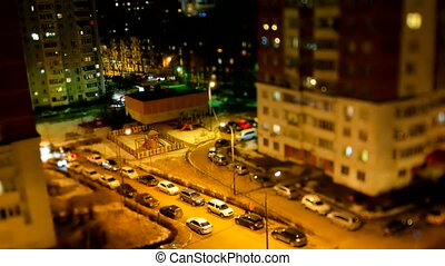 ODINTSOVO, RUSSIA - October 20, 2015. Timelapse clip of night street life. Aerial view of apartment buildings, parking cars and passerby.