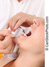 odontólogo, paciente, femininas