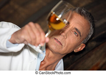 Oenologist analyzing a wine