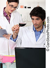 oenologists in a lab