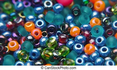 close-up of the movement of colored jewelry beads