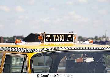 off duty - New York yellow taxi with roof sign