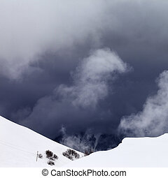 Off-piste slope and storm gray clouds - Off-piste snowy...