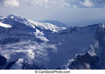 Off-piste slope at evening. Caucasus Mountains, Georgia, ski...