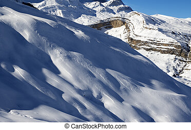 Off-piste slope at sun evening. Greater Caucasus, Mount...