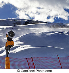 Off-piste slope during blizzard and sunlight blue sky with...