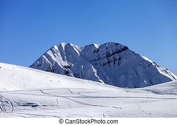 Off-piste slope in sun morning. Caucasus Mountains. Georgia,...