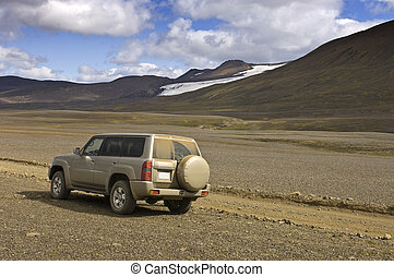 Off Road Adventure - A four by four car parked to observe...