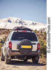 Off road car in snowy hill tops