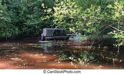 Off-road car in swamp - Off-road car driving in swamp