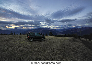 off road car in the mountain landscape