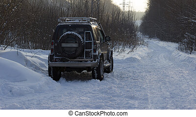 off-road car in winter forest