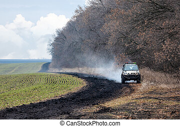 Off road car is driving on a bad dirty road.