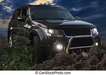 off-road crossover at night