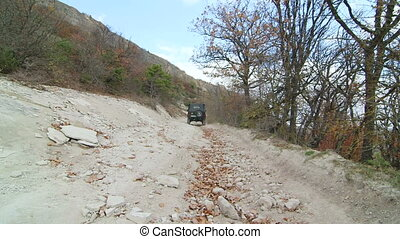 Off road driving on stony mountain track to Mangup in the...