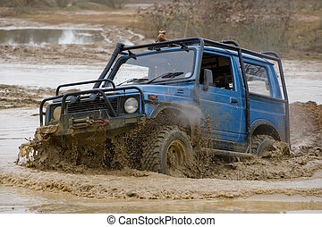 Off road driving - Driver competing in an off-road 4x4...