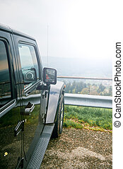 Off-road jeep car travel on mountain road,