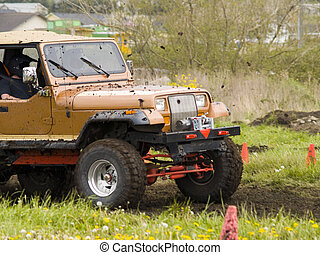 Off Road Racing - A truck racing through the mud in an off...