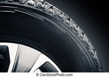 Off Road Tire and Alloy Wheel Closeup Photo.