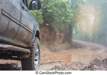 Off-road travel on mountain road, Adventure Travel, Rainy Season.