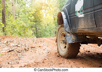 Off-road travel on mountain road. Outdoor, adventures, expedition, explore and travel suv.