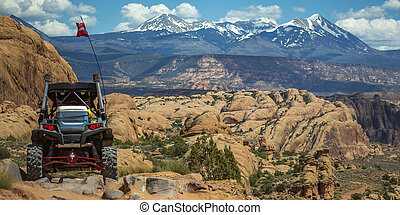 Off road vehicle and La Sal Mountain pano in Moab