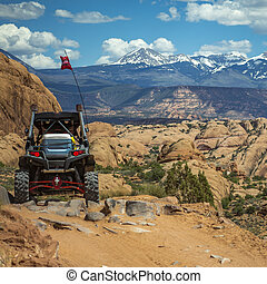 Off road vehicle and La Sal Mountain view in Moab