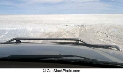 Off-road vehicle driving on Salar de Uyuni, Bolivia