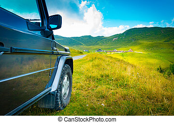 Off road vehicle on a mountain road
