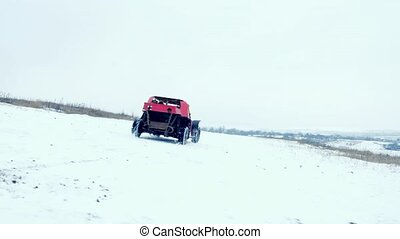 Off-road vehicle riding on the snow