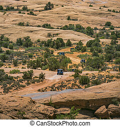 Off road vehicles on rugged terrain in Moab Utah. View of ...