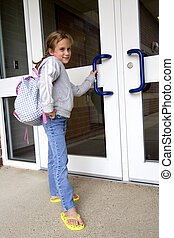 Off to school - Young grade school age girl heading off to...