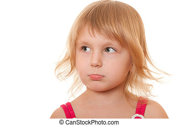 Offended little girl - A closeup portrait of an aggrieved ...