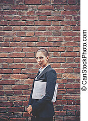 Offense - Image of angry businesswoman with document walking...